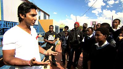 THINK WISE champion and Sri Lanka captain, Kumar Sangakkara, talking to youngsters at a love Life project, South Africa, about HIV and AIDS awareness.